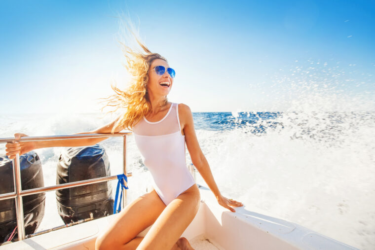 Happy,Overjoyed,Woman,On,A,Boat